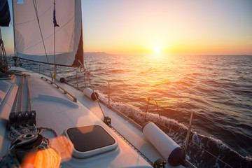 Wall Mural - Sailing ship yachts in the open Sea during fantastic sunset. Luxury boats..