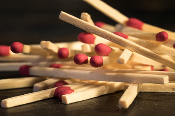 Unlit Matchsticks on black background