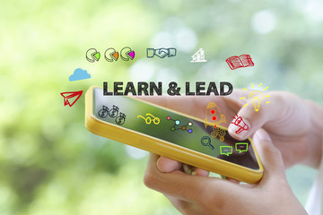 learn and lead over a smart phone on blur background , business