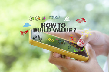 how to build value over a smart phone on blur background , busin