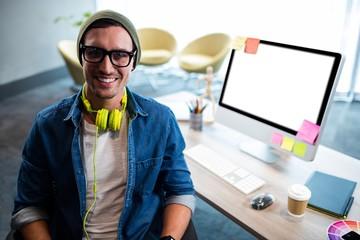 Smiling hipster businessman posing for camera