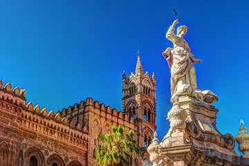 Spoed Fotobehang Palermo Sculpture in front of Palermo Cathedral church against blue sky, Sicily, Italy