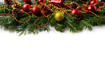 Christmas background with red ornaments and golden decorated pin