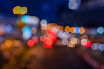 Night city street colorful lights bokeh background,  Abstract bokeh from car light on the traffic road.