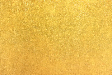 Bright gold color leather texture background