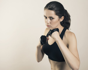 Young beauty woman sport isolated fight studio shot photo