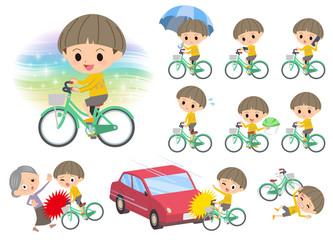 Yellow clothes Bobbed boy ride on city bicycle