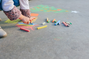 Girl draws on concrete