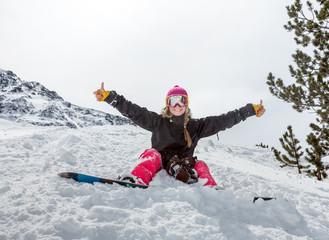 Joyful young woman snowboarder