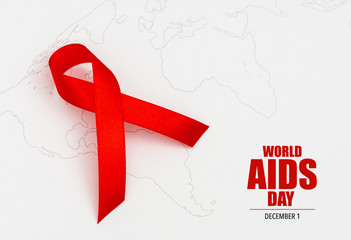 Aids Awareness Red heart Ribbon on world map .
