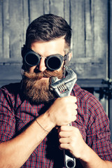 Bearded man hipster draws tooth