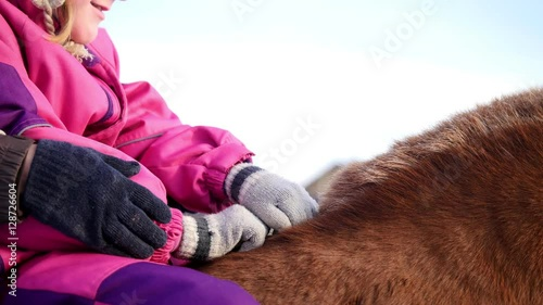 Hippotherapy for kid with cerebral palsy syndrome at winter