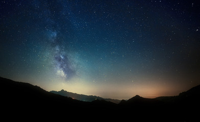 Aluminium Prints Night night sky stars with milky way on mountain background