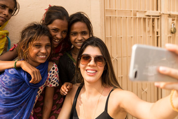 Tourist taking selfie with cute Indian girls