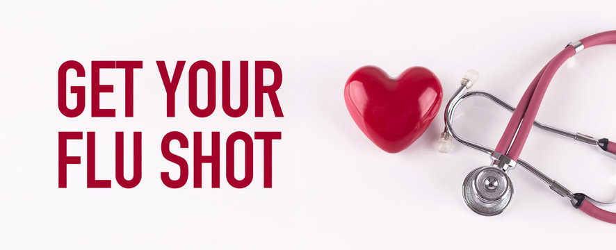GET YOUR FLU SHOT concept with stethoscope and heart shape