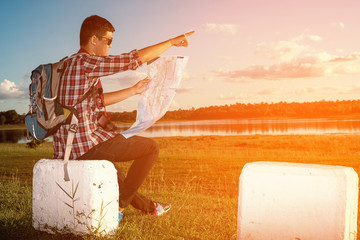 Young boy as he reads the map, traveling alone - lifestyle,people, outdoor and Holiday concept