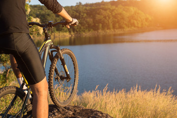 Cyclist on the mountain top of lake, Extreme and adventure life.