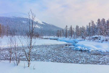 Winter landscape with river and mountain - ski resort