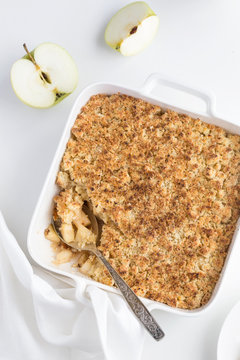 apple crumble pie in white baking dish