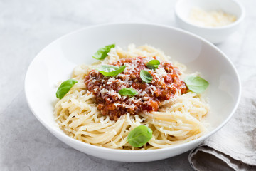 Spaghetti pasta with bolognese sauce and  parmesan cheese