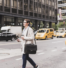 USA, New York City, woman in Manhattan on the go