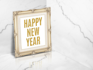 Happy new year word on vintage golden photo frame at white gloss