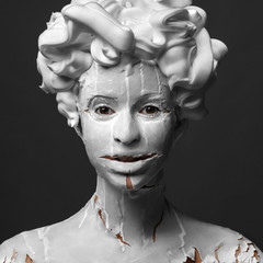Minimalistic art portrait of woman, who looks like a statue
