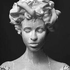 Minimalistic art portrait of woman, who looks like a statue