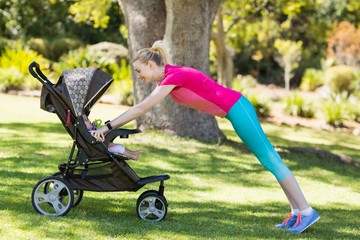 Woman exercising with baby stroller