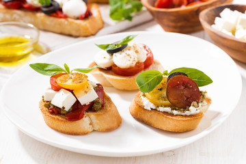 bruschettas with tomatoes and mozzarella on plate