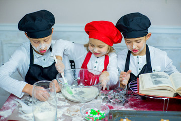 children baking christmas cookies