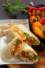 Burritos wraps with chicken and vegetables.