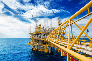 Oil and gas platform or Construction platform. power business concept. offshore rig plant. energy concept. stock investment Wall mural