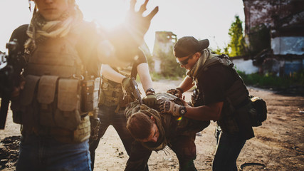 Terrorists with weapon captured journalist hostage.