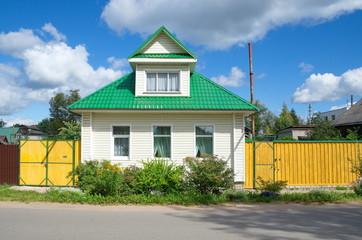 Ostashkov, Tver region. The house is sheathed with siding