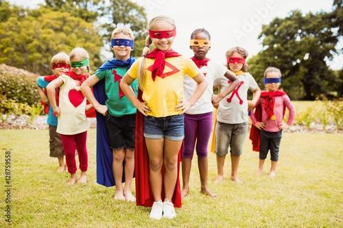 Children wearing superhero costume standing