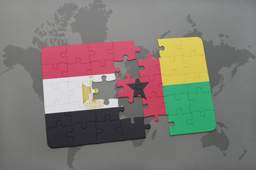 puzzle with the national flag of egypt and guinea bissau on a world map.
