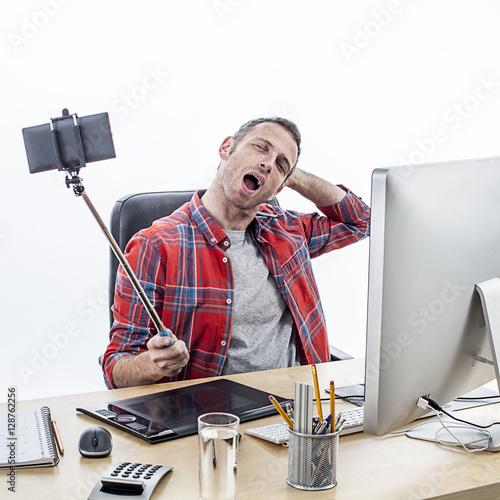 excited casual business man posing for a sexy office selfie photo libre de droits sur la. Black Bedroom Furniture Sets. Home Design Ideas