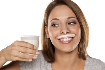 happy young beautiful woman with a yogurt mustache