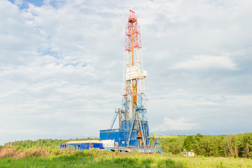 Land oil drilling rig blue sky