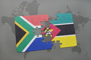 puzzle with the national flag of south africa and mozambique on a world map.
