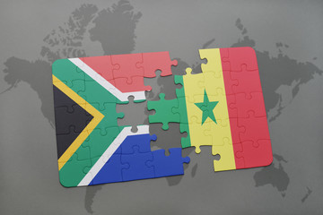 puzzle with the national flag of south africa and senegal on a world map.