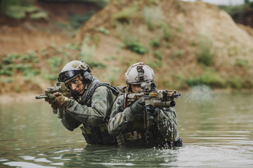 Military team crossing the river under fire