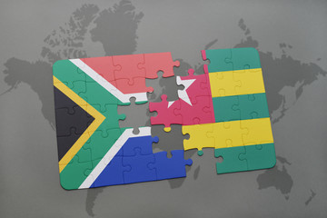 puzzle with the national flag of south africa and togo on a world map.