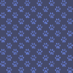 Muddy looking paw prints in middle blue against darker blue background, a seamless background pattern