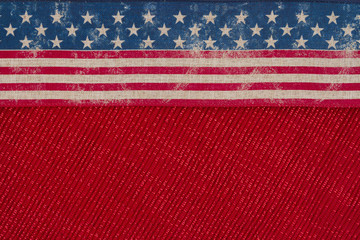 USA patriotic old flag on a red fabric background