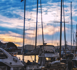 Yacht masts silhouette at beautiful twilight sky background in Bergen city marina, Norway