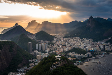 Wall Mural - Sun is shining through the clouds on the Rio de Janeiro city, View from the Sugarloaf Mountain