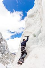 Mountaineer climbing ice wall mountain glacier mountain, Bolivia