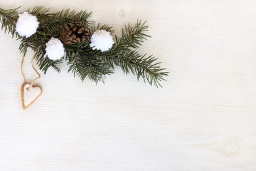 favorite winter holiday/ green Christmas tree branch decorated with gingerbread heart shaped